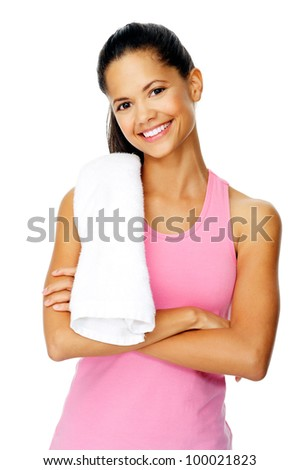 healthy fit woman with gym towel stands with confidence and smiles isolated on white