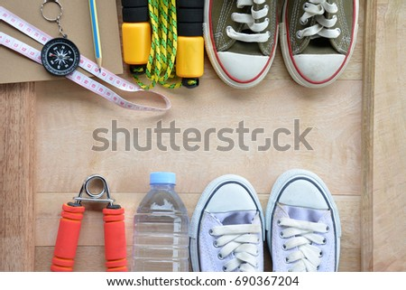 Healthy fitness  concept with Exercise Equipment and fruit lose weight on floor background.