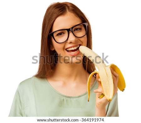 Healthy food. A young girl holding a banana isolated on a white background - stock photo