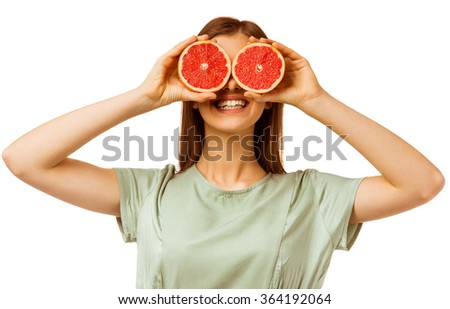 Healthy food. A young girl holding an orange, isolated on a white background - stock photo