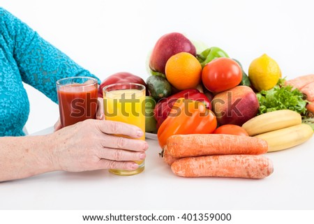 Healthy food and drinks: vegetables, fruits and fresh juices isolated on white background - stock photo