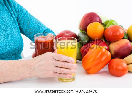 Healthy food and drinks: vegetables, fruits and fresh juices laying on the table, isolated on white background - stock photo