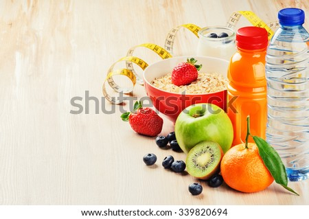 Healthy food and fitness concept. Fresh fruits, juice and cereal - stock photo