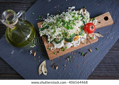 Healthy food and ingredients with tomato, cucumber, cabbage, green onion, egg and spices on dark background. Cooking concept. Top view. - stock photo