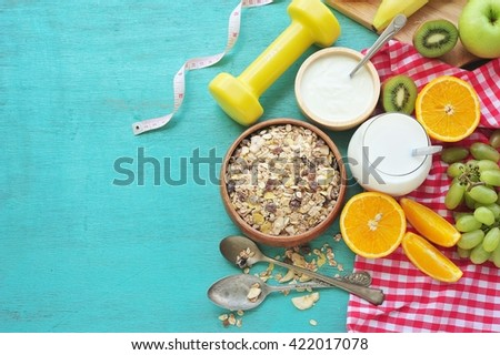 Healthy food and tape measure over wooden table. Fitness and health. - stock photo