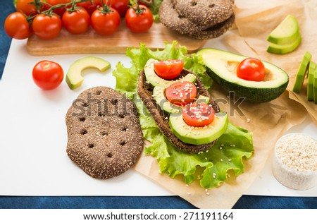Healthy food. Avocado Sandwich with Cherry Tomatoes and Lettuce - stock photo