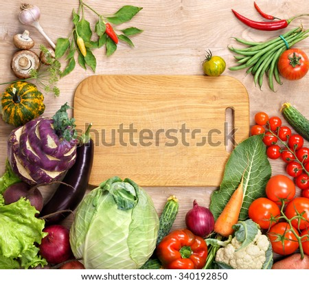 Healthy food background and Copy space / studio photography of open blank ring bound notebook surrounded by a fresh vegetables and pencil on old wooden table. High resolution product. - stock photo