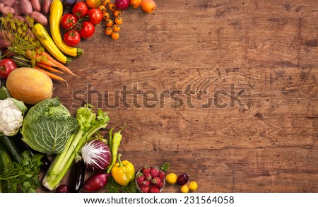 Healthy food background / studio photo of different fruits and vegetables on old wooden table