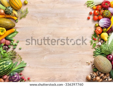 Healthy food background / studio photo of different fruits and vegetables on old wooden table. Copy spacy for your text. High resolution product - stock photo