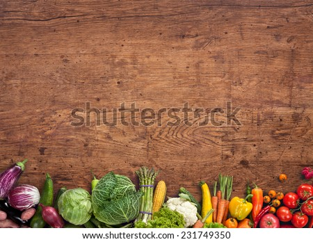 Healthy food background / studio photography of different fruits and vegetables on old wooden table   - stock photo