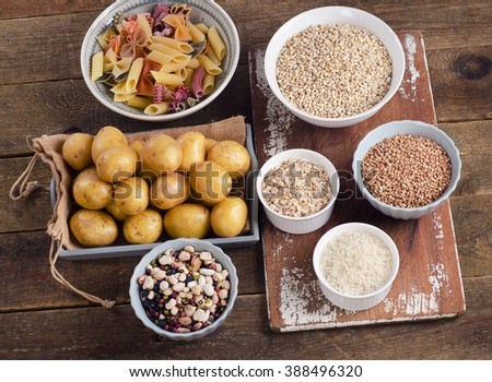 Healthy Food: Best Sources of Carbs on rustic wooden background. Top view - stock photo