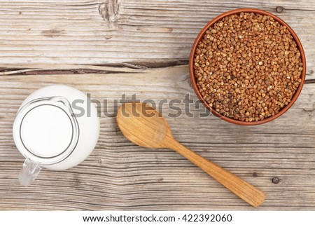 Healthy food. buckwheat and milk on a wooden background. - stock photo