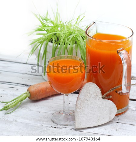 Healthy food, carrots and carrots juice - stock photo