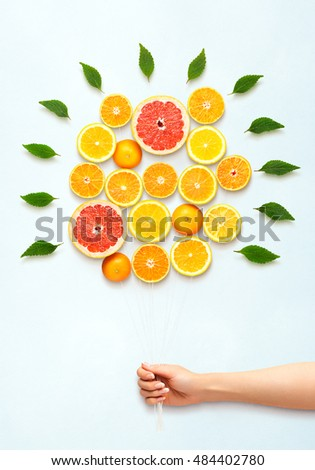 Healthy food concept and creative still life of bouquet made of fresh citrus fruits.