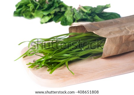Healthy food concept: green raw italian pasta with its natural vegetable dye - spinach on wooden desk isolated over white background. Shot in shallow depth of field - stock photo
