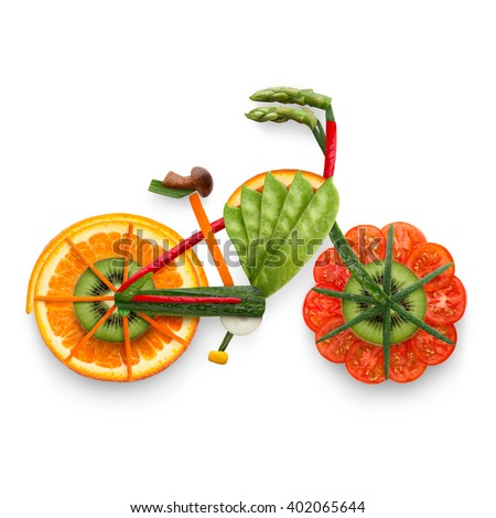 Healthy food concept of an electric bicycle in detail made of fresh vegetables and fruits full of vitamins, isolated on white. - stock photo