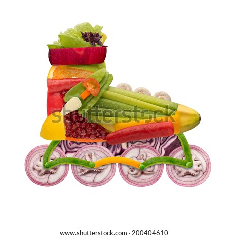 Healthy food concept of inline roller skate made of fresh vegetables full of vitamins, isolated on white. - stock photo