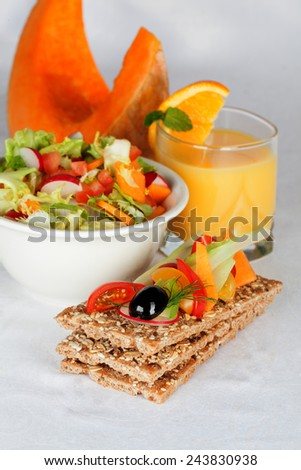 healthy food, crispbread with fruits and vegetable, pumpkin still life - stock photo