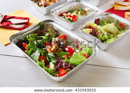 Healthy food delivery. Fitness food. Weight loss nutrition diet. Eat right concept, healthy food, clean food take away in aluminium boxes, vegetable salads and meat at white wooden table closeup - stock photo