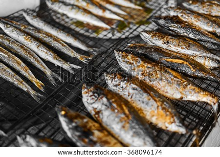 Healthy Food. Fish Cooking. Closeup Of Fresh Grilled ( Fried ) Mackerel Fish On Grill At Fish Market In Thailand, Asia. Thai Cuisine, Meal, Dish. Seafood Eating. Nutrition, Diet. - stock photo