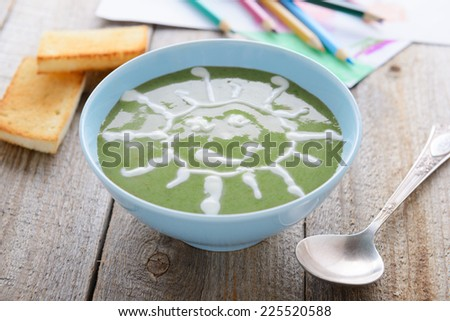 Healthy food for children - spinach cream soup - stock photo