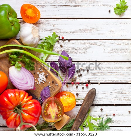 Healthy food. Fresh veggie ingredients and spices for cooking salad. - stock photo