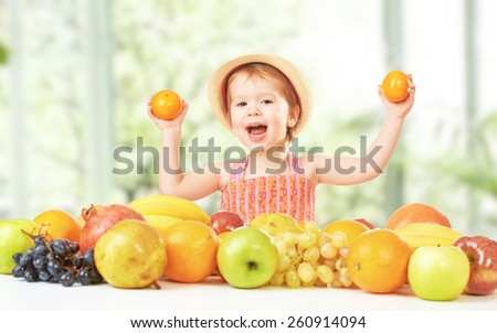 healthy food. happy child girl and a lot of fruit - stock photo
