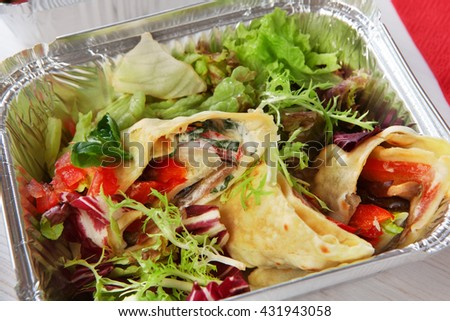 Healthy food in box. Natural organic food. Weight loss diet, low carb lunch take away in aluminium container. Healthy food background. Vegetable salad with crepe closeup at white wooden table - stock photo