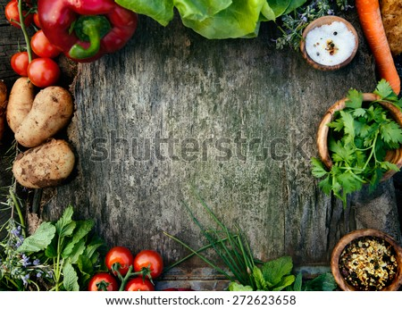 Healthy food ingredients background. Vegetables, herbs and spices. Organic vegetables on wood - stock photo