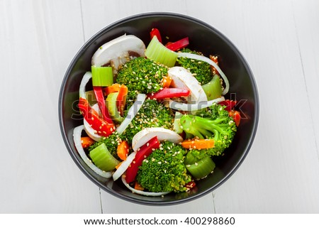 Healthy food made of broccoli, onion, mushroom, carrot and pepper. Vegetarian salad. Top view.