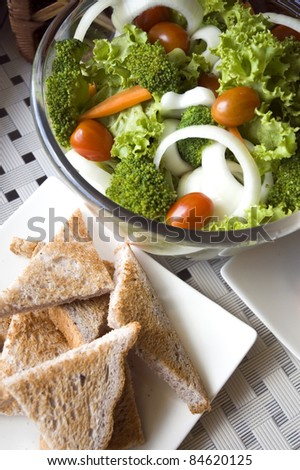 Healthy food mixed salad and wheat toast - stock photo