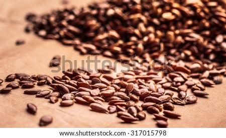 Healthy food organic nutrition. Flax seeds linseed heap closeup - stock photo