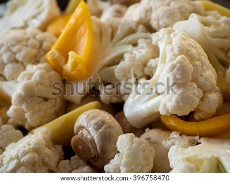 Healthy food: raw cauliflower, mushrooms and yellow bell pepper. Shallow depth of field.