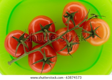 Healthy food series with red tomatoes on the vine and light background