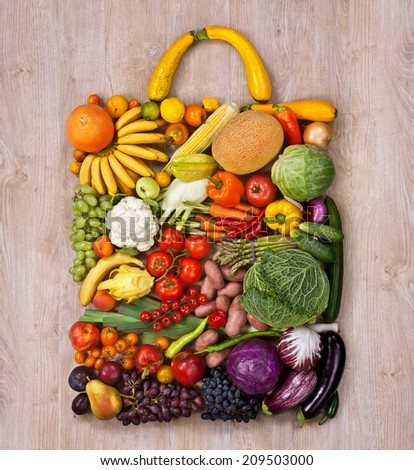 Healthy food shopping / food photography of designer handbag made from different fruits and vegetables on wooden table  - stock photo