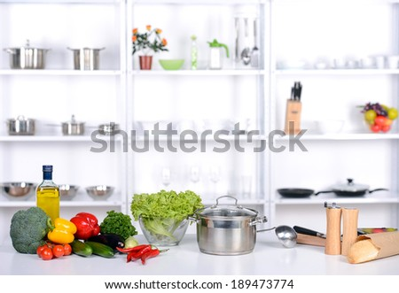 Healthy foods are on the table in the kitchen - stock photo
