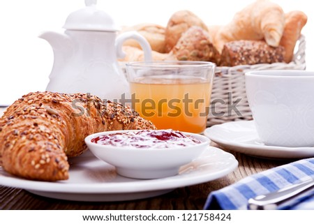 healthy french breakfast coffee croissant on wooden table