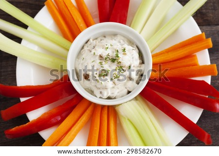 Healthy French onion dip with caramelised onion, Greek yogurt and fresh herb thyme with fresh vegetables.