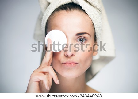 Healthy fresh girl with cotton swab and towel on head