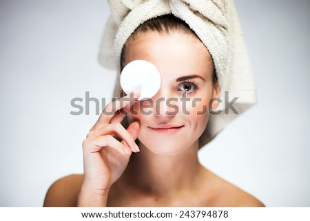 Healthy fresh girl with cotton swab and towel on head - stock photo
