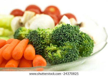 Healthy fresh vegetables arranged as a tasty appetizer salad plate. Shallow depth of field.