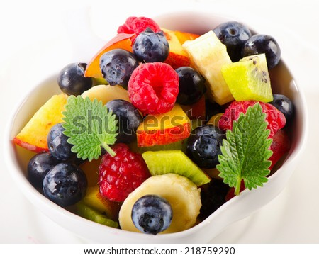 Healthy fruit salad in a white bowl. Selective focus
