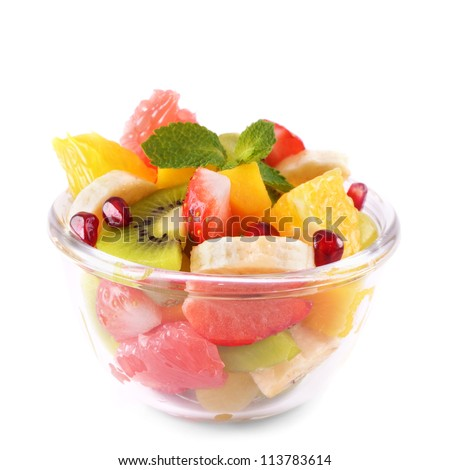 Healthy fruit salad in the glass bowl isolated on white - stock photo