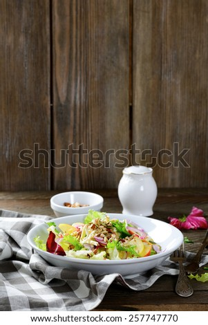 Healthy fruit salad on a plate, wooden background - stock photo