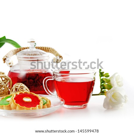 Healthy fruit Tea in a glass cup isolated in white. Shallow DOF.