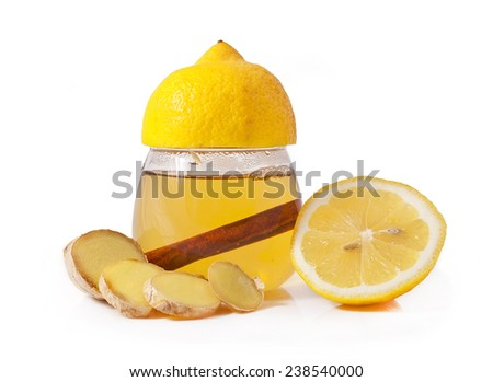 Healthy ginger tea with lemon and cinnamon isolated on white background  - stock photo
