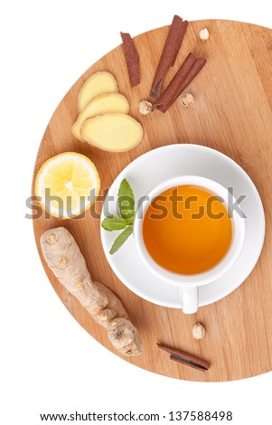 Healthy ginger tea with lemon and spices - stock photo