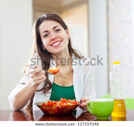 healthy girl eating vegetarian lunch at home - stock photo