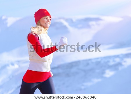 Healthy girl running outdoor, active sportive female exercising, weight loss cardio program, woman enjoys jog in winter, sport and fitness lifestyle - stock photo