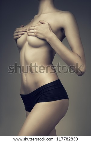 healthy girl with hands on breasts - stock photo